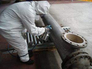 Heat resistant coating application on metal pipe