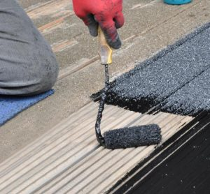 Man applying anti slip paint on wood