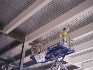 Applying a fire resistant paint to metal