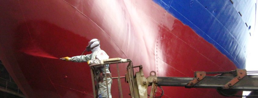 antifouling paint being applied on ship