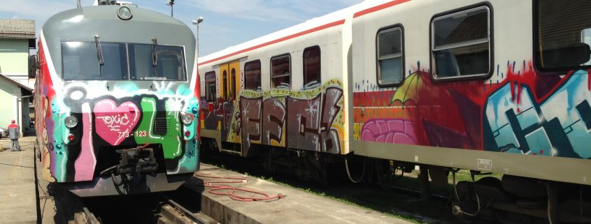 trains with graffiti and anti graffiti paint for easy removal