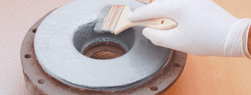 Chemical resistant coatings being applied on a machine part as chemical coatings