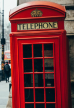 red telephone booth with red coating in london