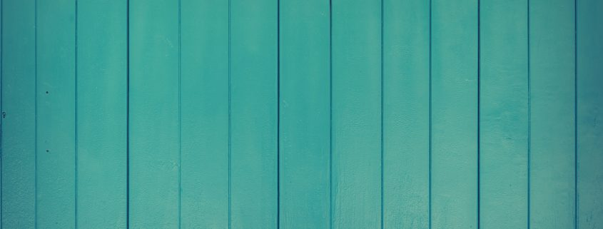 exterior wood cladding with green timber cladding paint