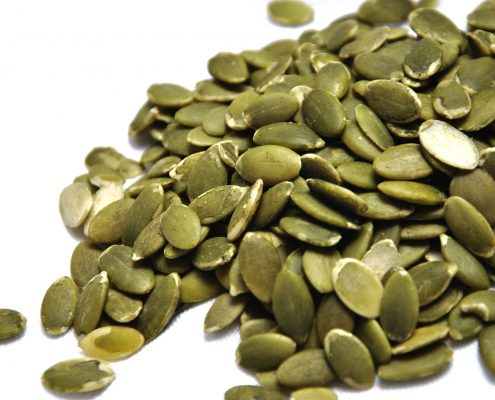Seed coating on pumpkin seeds