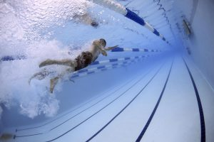 Underwater man swimming in pool
