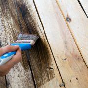 applying a brown wood coating primer