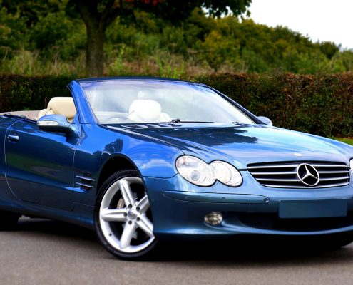 glass coating for cars on a blue mercedes