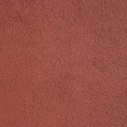 Red fine textured masonry paint as it appears when dry