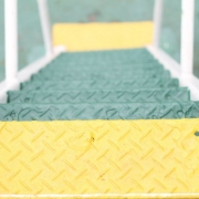 green and yellow anti slip paint for metal applied on metal stairs