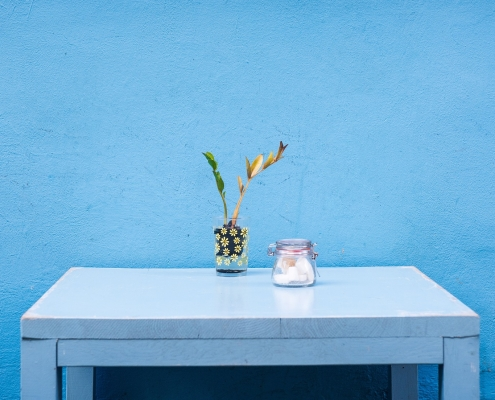 chalk paint furniture in blue on a table