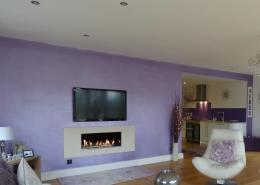 purple metallic wall paint on a living room wall