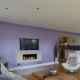 purple metallic wall paint on a living room wall